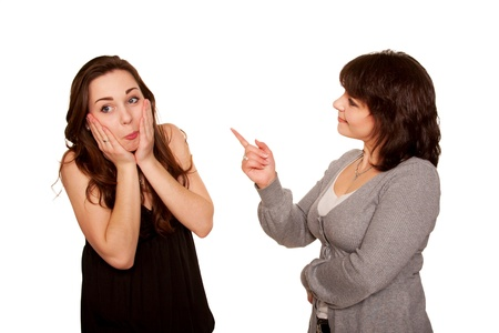 scolding: Mother scolding her teen daughter.  Isolated on white background. Stock Photo