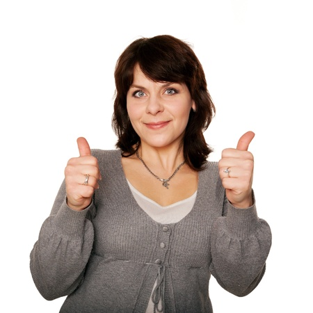 Middle-aged woman showing thumbs up sign. Isolated on white background