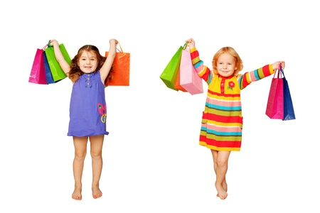 happy shopping: Two little girls with their purchases and gifts Stock Photo