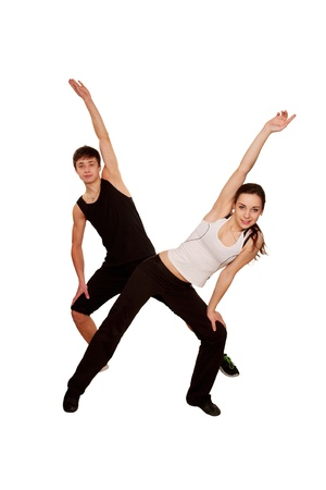 sporting activity: Teens playing sports, fitness workout. Boy and girl doing exercise together. Isolated on white background Stock Photo