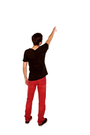 Teen boy pointing at something. Rear view. Isolated on white background. photo