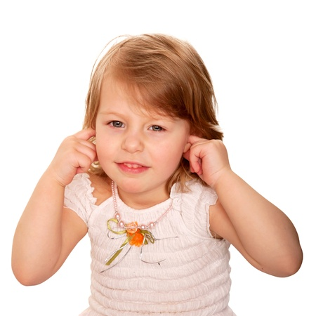 deaf: Little girl closing ears with fingers. Isolated on white background