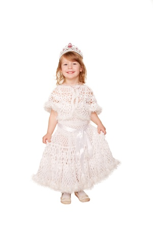 Smiling little girl in a white dress and a crown. Isolated on white background photo