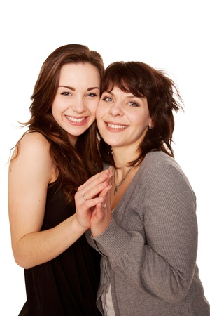 Mother and teenage daughter together Isolated on white background photo