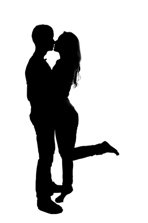 sexy couple black background: Silhouette of a young couple in love. Isolated on white background