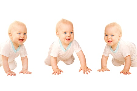 Three happy babies crawling and laughing. Isolated on white background.