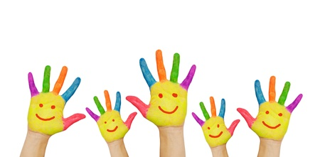 charitable: Childrens smiling colorful hands raised up. The concept of classroom or back to school. Isolated on white background