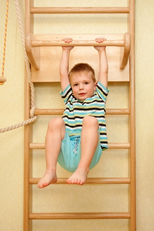 Little child pulling up on a bar Stock Photo - 20383734