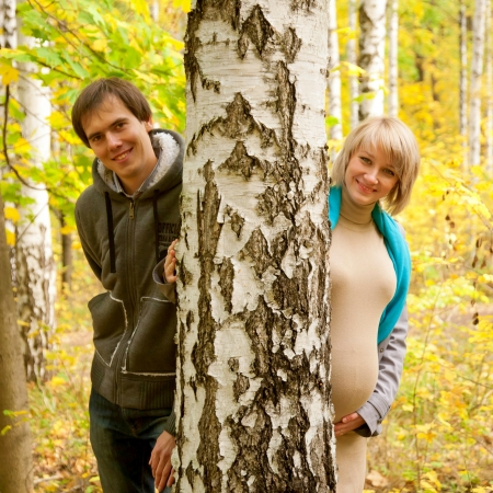 Young couple in love in the autumn forest near the birch   photo