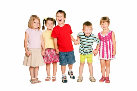 Group of little children holding hands and smiling. Friendship, school and union concept. Isolated on white background Stock Photo