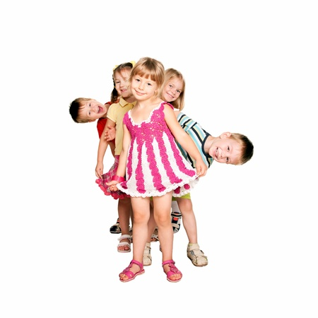 school aged: Group of fun children playing and laughing. Isolated on white background Stock Photo