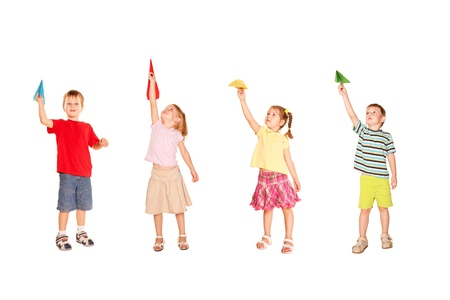 throw paper: Group of children playing with paper airplanes, starting them fly up. Isolated on white background. Stock Photo