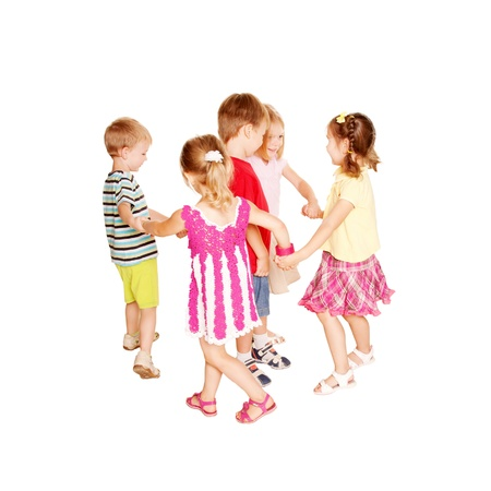 Group of little children dancing, holding hands and having fun. Joyful party. Isolated on white background.