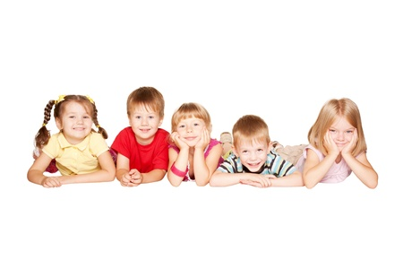 preschool education: Group of children having fun, lying on the floor. Isolated on white background