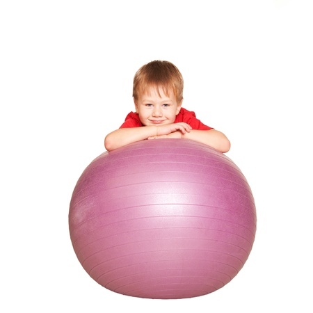 child ball: Little boy with the fitness ball. A healthy lifestyle since the childhood. Isolated on white background