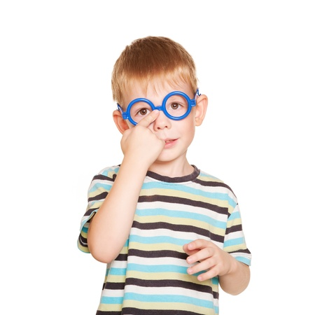 Little boy adjusting his glasses. Isolated on white background photo