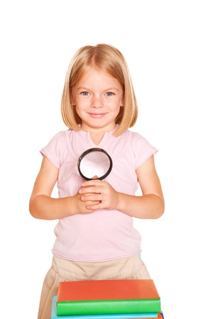 Little girl with books and magnifying glass. Isolated on white background Stock Photo - 21171503