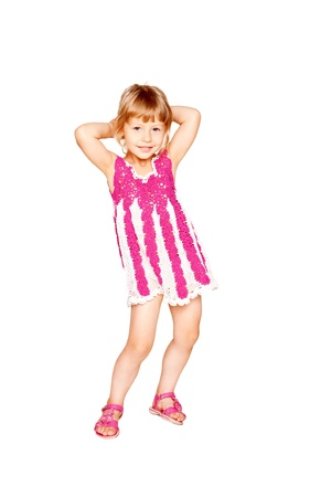 Pretty little girl in a knitted dress dancing. Isolated on white background photo