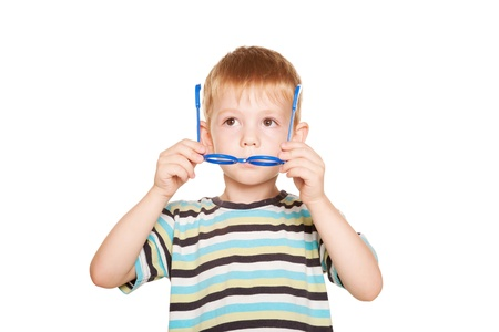 Happy little boy adjusting his glasses. Isolated on white background Stock Photo - 21575043