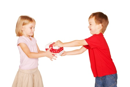 Little boy giving a little girl a gift. Present for a birthday, valentines day or other holiday, ready for your textor symbols.. Isolated on white background photo