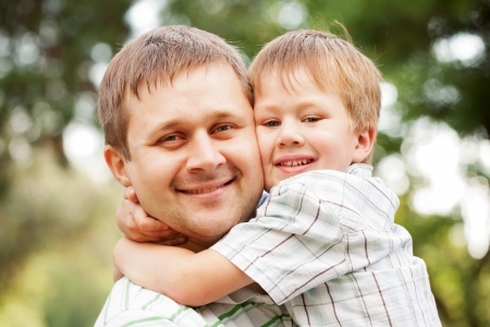 paternity: Happy father and son outdoors.  Child hugging daddy. Stock Photo