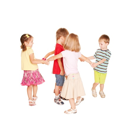 Group of small kids dancing, holding hands and having fun. Joyful party. Isolated on white background.