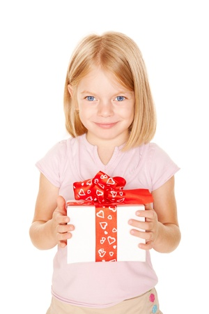 Little girl with gift. Holiday concept. Ready for your text or symbol. Isolated on white background photo