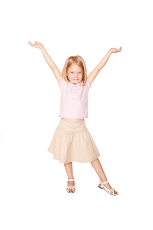 Happy little girl dancing. Isolated on white background photo