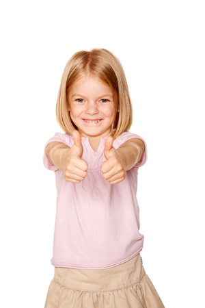 ok symbol: Happy little girl showing a thumbs up sign or OK symbol. Isolated on white background