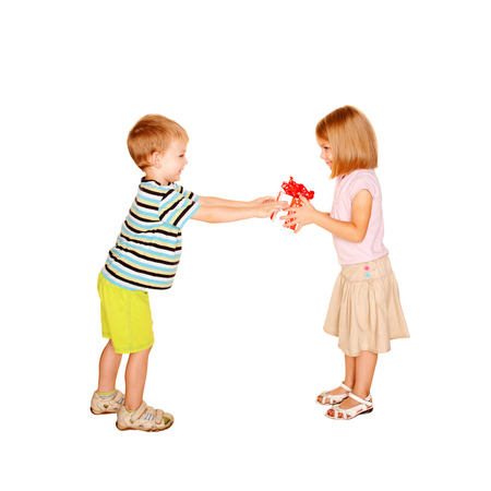 Little boy giving to little girl the gift  Present for birthday, valentine photo