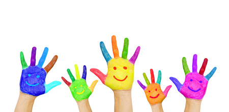 Painted in different colors smiling hands, ready for your text or symbols  Isolated on white background Stockfoto