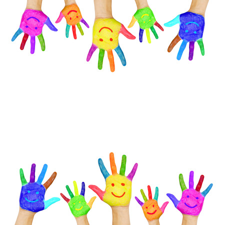 Frame of colorful hands painted with smiling faces  Fun, joy, happiness and good cheer  Baby, child and adult hands  Joyful party or celebration  Isolated on white background