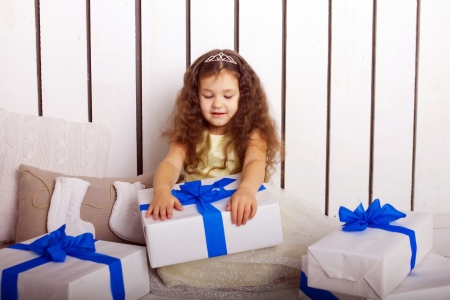 Happy little girl holding Christmas gifts  Christmas, New Year concept photo