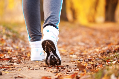 Close-up running feet outdoors. Healthy lifestyle, fitness, jogging, active, young concept.