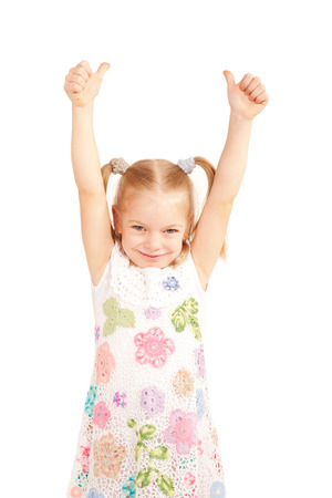 upwards: Smiling child showing thumbs up symbol and hands up. Isolated on white