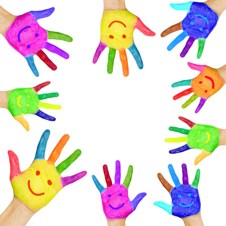 Frame formed from human hands painted in colorful paint with smiles.  Isolated on white  photo