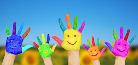 happy team: Smiling hands on summer background. Summer holidays and fun games concept .