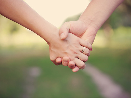lovers embracing: Two people holding hands outdoor  Friendship and family concept  Stock Photo