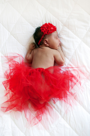 Baby ballerina. Black newborn baby sleeping peacefully. photo