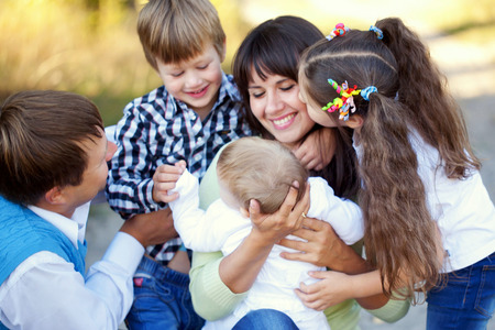 large family: Large family hugging. Father, mother, son, daughter and baby together. Happy family concept Stock Photo
