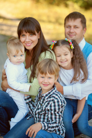 happy family concept: Large family hugging. Father, mother, son, daughter and baby together. Happy family concept Stock Photo
