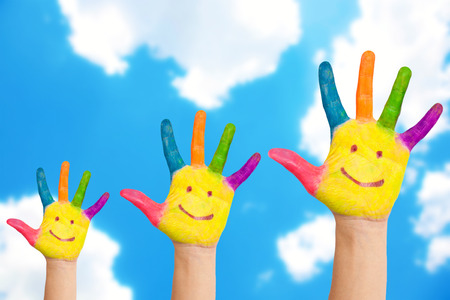 Smiling family hands on a sky background. Happiness and success concept. photo