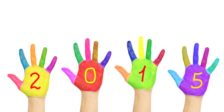 Kid`s colorful hands forming number 2015. Isolated on white background. The symbol of the new year photo