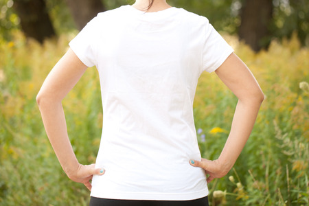Young woman in white t-shirt outdoors photo