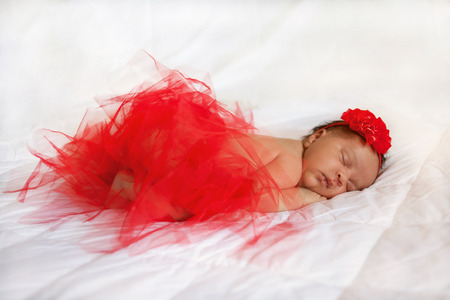 Black newborn baby sleeping peacefully. Mulatto newborn baby girl photo