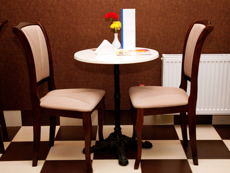Cozy table and two chairs in the cafe. For Love couple or meeting friends. photo