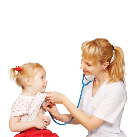 Friendly doctor performs auscultation of heart and lungs of the recovered baby kid. Isolated on white background photo