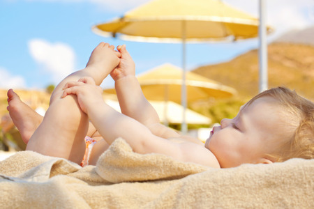 Summer vacation concept. Happy baby on the beach.