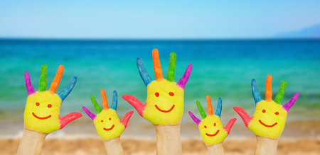 Children smiley hands on a beach background Stockfoto