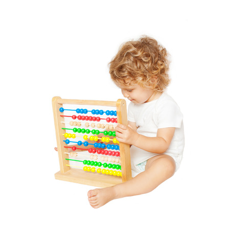 able to learn: Smiling baby playing with abacus. Isolated on white background